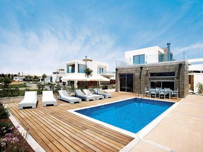 Photo for Contemporary air-conditioned villa near beach w/ heated pool and Wi-Fi