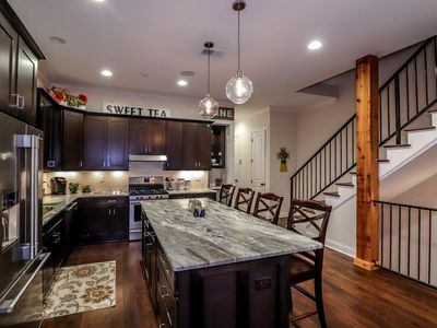 Photo for Beautiful Spacious Condo walk to Football and Baseball games, 1.1 mile to square