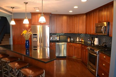 Well appointed kitchen with stainless steel appliances.  Open floor plan.