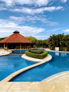 Photo for Modern, condo with resort-style pool. 6 minutes to Tamarindo