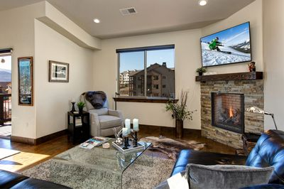 Living Room - Warm up by the fireplace and watch your favorite movies or shows.