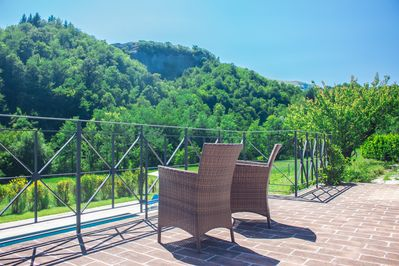 Covered terrace view of beautiful private pool in secluded valley.