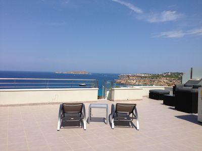 Photo for Extraordinary sunset views, brand new 3 bed duplex apartment, 200m from beach