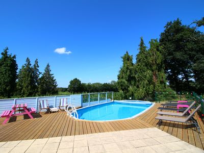 Photo for Quaint rural cottage in a quiet hamlet with shared heated outdoor swimming pool.