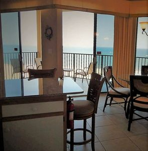 Kitchen and dining view, overlooks the balcony with panoramic gulf views.