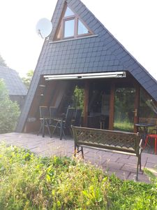 Photo for Cozy Eifel holiday home in a beautiful holiday village near Freilinger See