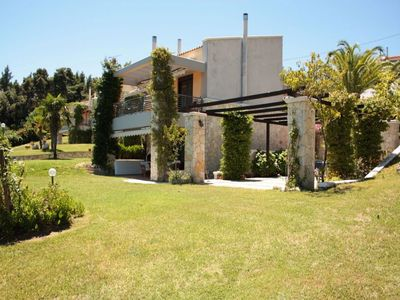 Photo for Exclusive maisonette with a swimming pool, surrounded by forest