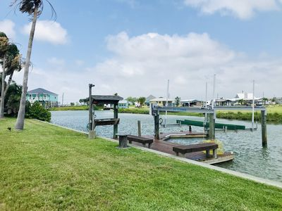 Photo for Getaway and relax at this home on a canal that leads out to the best fishing!