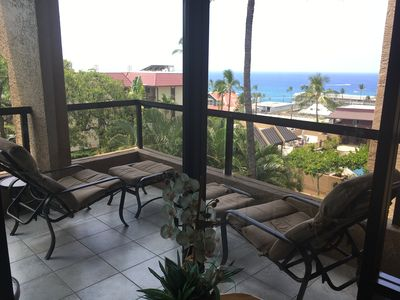Wraparound lanai has a great view of the ocean. New Tropitone padded loungers!