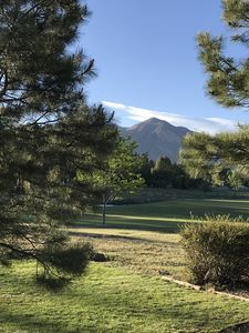 Photo for Four seasons relaxation with mountain views in this beautiful golf course home.