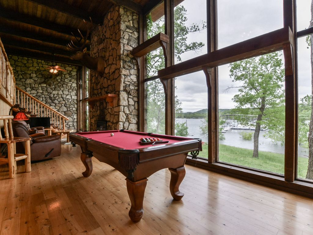 Enjoy A Friendly Game Of Pool With Beautiful Lake Views.