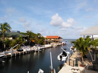 Open Bay access. Spacious deck w/seating, fish station/dock boxes/shower/pool