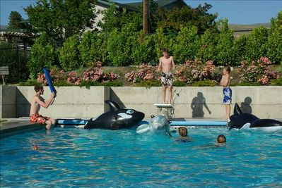 Kids and blow up orcas go together in the pool! (open end of May - October)