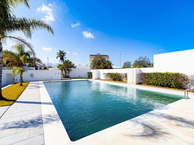 Photo for Modern Apartment Close to the Beach with Air Conditioning, Wi-Fi, Terrace and Fantastic Sea View