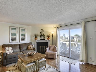 Photo for FREE DAILY ACTIVITIES!!! BOAT DOCK!!!  FREE WIFI!! PARKING FOR 2 CARS!!  Updated 3 BR Canalfront in North Ocean City