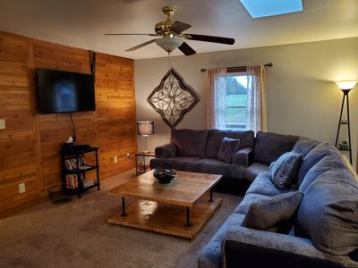 Large sectional couch in the main living room. Dish network and DVD's provided.