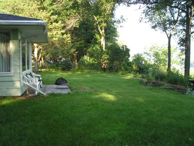 This is a view of the back yard, showing the windows that overlook the river.