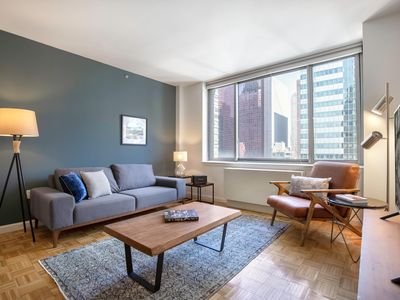 Photo for Hip Midtown West 2BR w/ roomy sundeck, gym, near Times Sq by Blueground