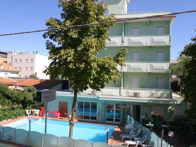 Photo for Holiday apartment with air conditioning, just 50 meters from the beach