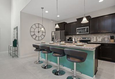 Amazing kitchen view with elegant clock and barstool seating
