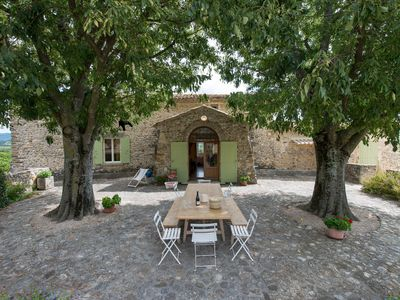 Photo for Secluded old Provencal farmhouse with vines, pool and stunning views