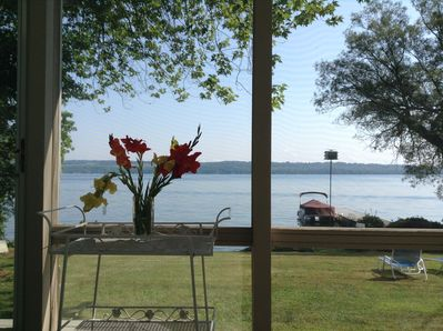 View from screened porch, living room, dining room, kitchen to lake
