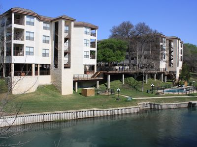 Photo for Comal Riverfront Condo w/Pool, River Access & Park, Schlitterbahn across street