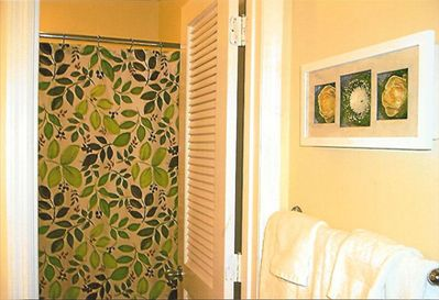 Yellow and green decor in the bathroom to coordinate with the bedroom