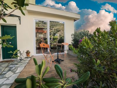Photo for Design apartment on the ground floor of a villa in a typical Ligurian village,