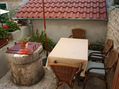Photo for Studio flat with terrace Vrboska, Hvar (AS-4601-a)