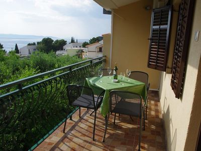 Photo for Two bedroom apartment with terrace and sea view Podgora, Makarska (A-6779-a)