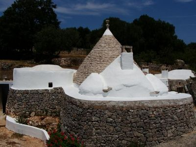 Photo for Cool in summer and panoramic 3 buildings with Trulli and 12. 000 m² of land