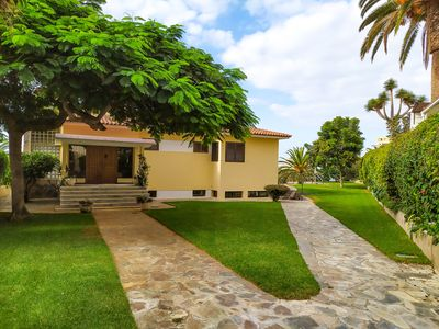 Photo for Urban villa surrounded by gardens with views over the city and the sea