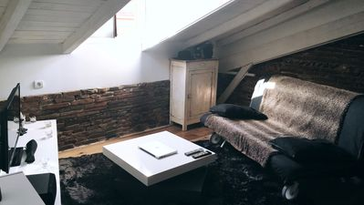 Photo for Charming atypical apartment with apparent brick