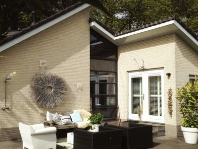 Photo for Detached holiday home in Schoorl with car charging station, at the edge of the forest, near the sea