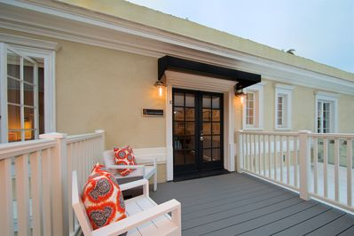Front entry deck w/ seating and BBQ for evening enjoyment.