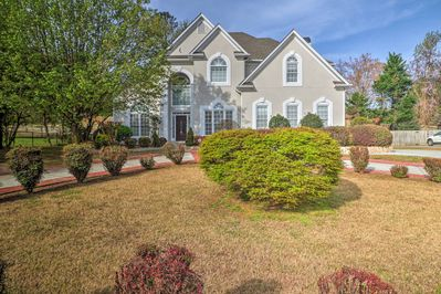 This home boasts great outdoor landscaping, 4 bedrooms, and 3 bathrooms inside.