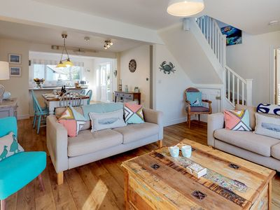 Photo for Contemporary coastal design, spacious living areas, elegant bedrooms and an pretty enclosed garden m