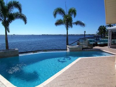 Photo for The River View - SE Cape Coral Riverfront, Luxury Pool Home, Contemporary Furnished, Sony Playstatio