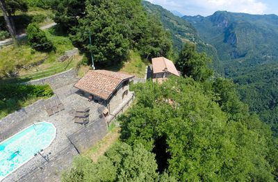 ENTRANCE GATE AT TOP LEFT, FRONT POOL, METATO THEN FARMHOUSE VALLEY BEHIND