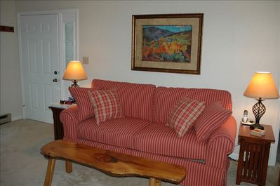 Comfy sofa with nesting tables on either side