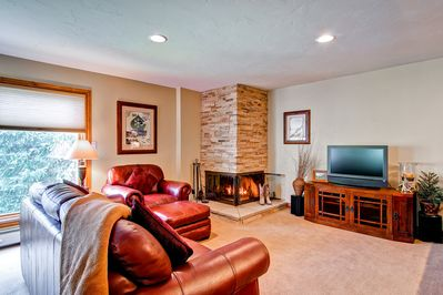 Living room - This lovely living room has a wood burning fireplace and flat screen TV