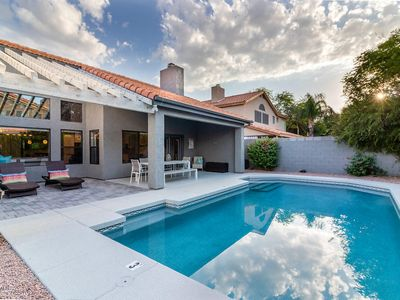 Photo for Resort style backyard with Pool, Grill, Yard Games Lounge Chairs and Outdoor Dining!
