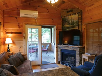 Photo for Riverfront Log Cabin w/Huge Deck, Fireplace, Hot Tub, W/D, D/W & More! (1-6 ppl)