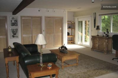 View of great room living area with sliding door to deck