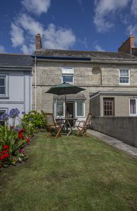 Photo for A Beautifully Maintained Cornish Cottage close to the lovely harbour and beach