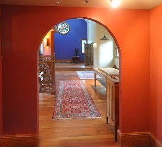 I created this archway to frame the stained glass at the other end of the house.