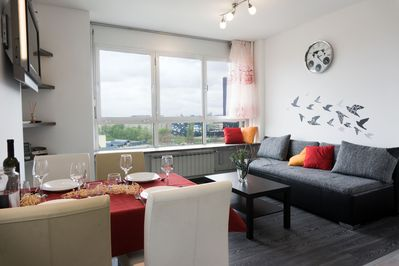 Living room with dining area - window bench is great for enjoying the view