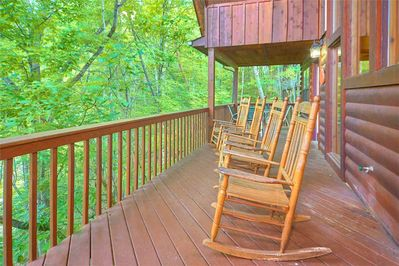 The great outdoors - There's plenty of room—and plenty of seating—on the covered deck so that everyone can revel in the fresh mountain breeze, the sun-dappled trees, and the singing of larks and warblers.