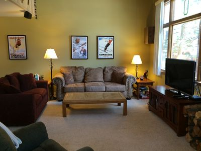 Living room with couch, loveseat, and easychair